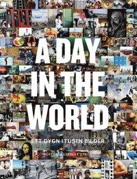 A day in the world : ett dygn i tusen bilder (inbunden)