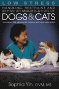Low Stress Handling Restraint and Behavior Modification of Dogs &; Cats