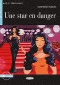 Une Star en danger. Buch + Audio-CD